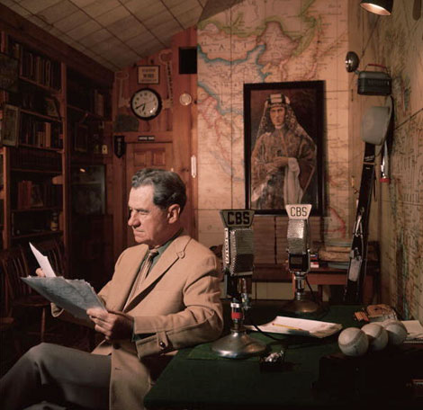 Lowell Thomas in his home, a portrait of T.E. Lawrence in the back
